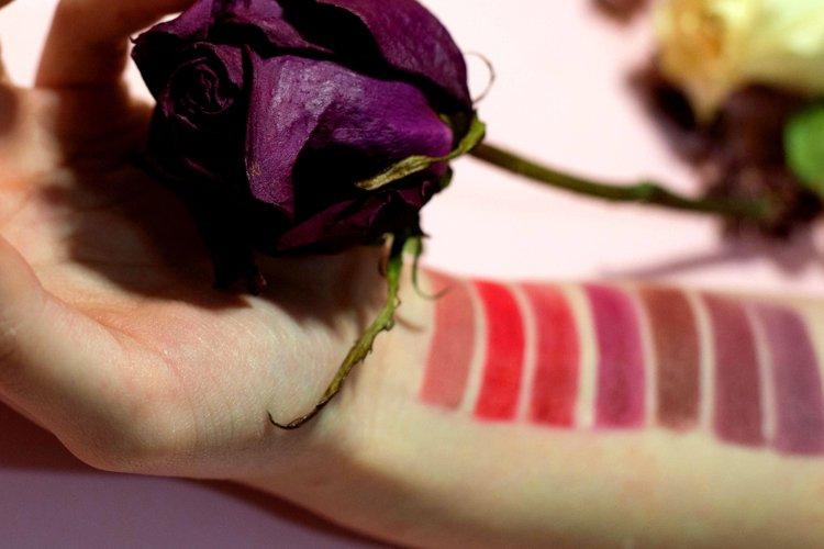Lipstick color palette on a womans hand