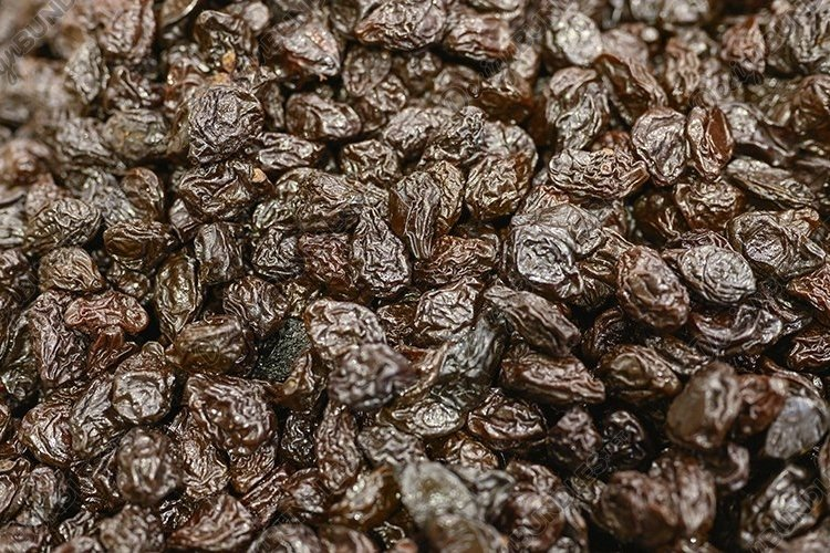 prunes a pile of dried fruits as a background example image 1