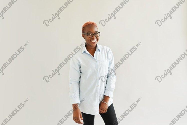 black woman with a short pink hair looking at camera example image 1