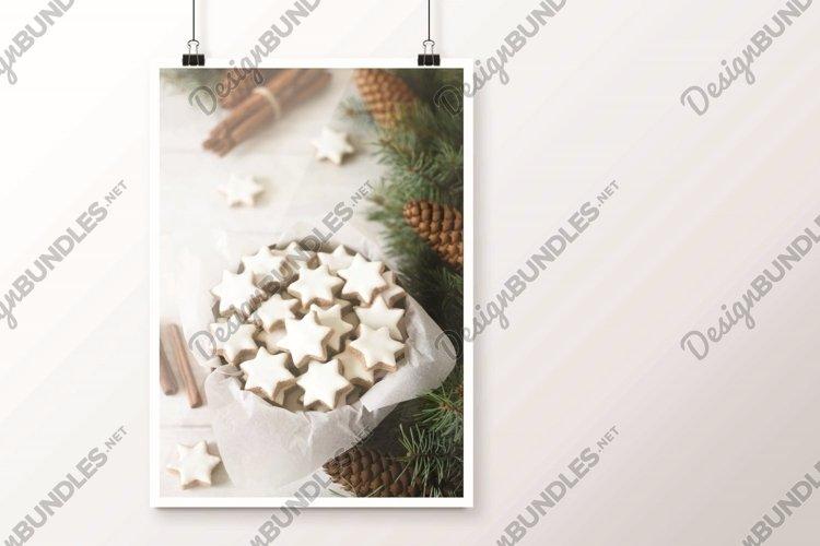 Cookies cinnamon star in a tin box. example image 1