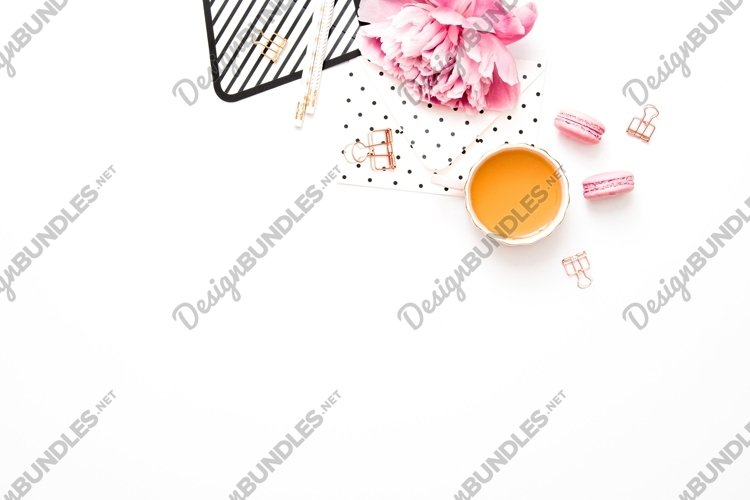 Flat lay with peony, gold and pink colored desk items