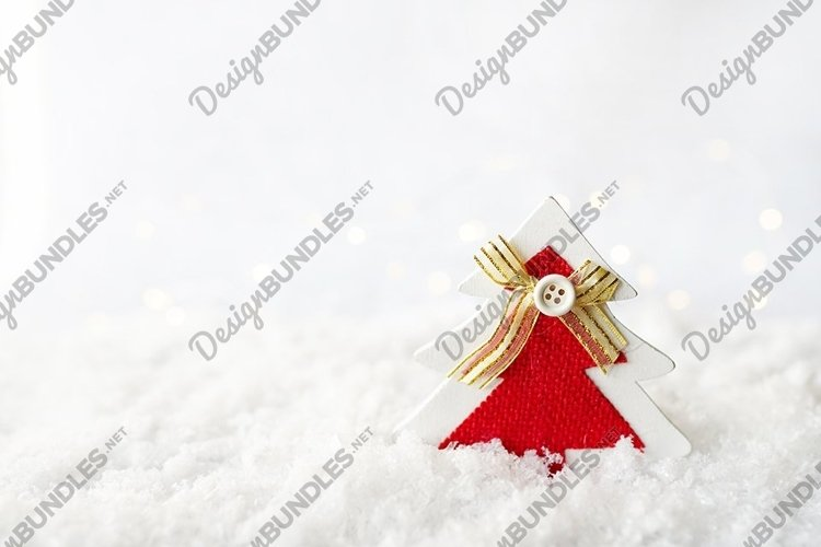 red christmas tree decor staying on the snow, copy space example image 1
