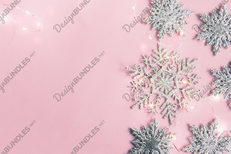 Christmas decor snowflakes with garland on pink background. example image 1