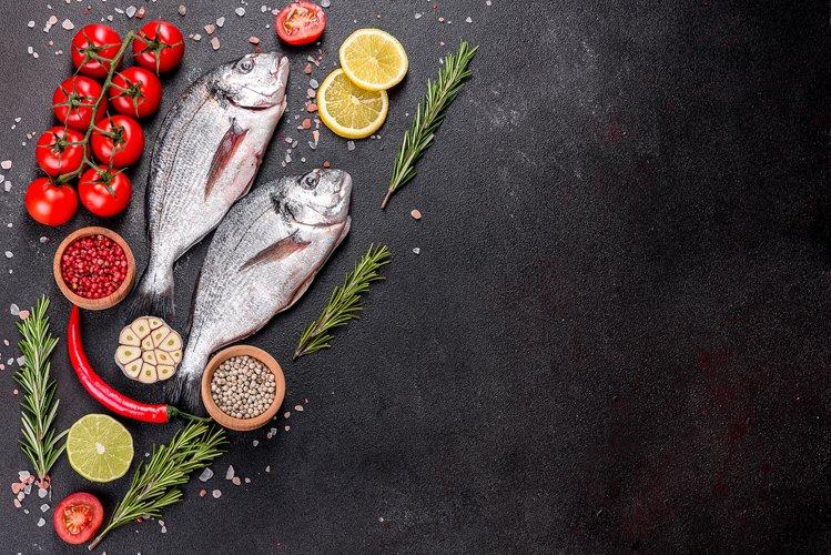 Raw dorado fish with spices. 5 photos