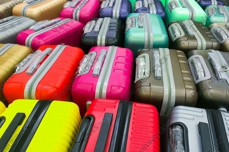 Many new multi-colored large plastic suitcases. Background