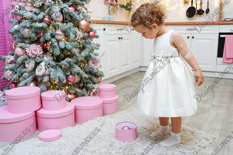 little child girl staying in the Christmas kitchen example image 1
