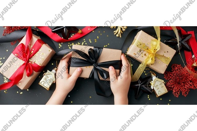 Christmas gifts, presents, ornaments on black holiday example image 1