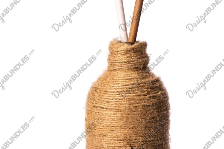 Two drinking straws of recycled paper in glass bottle example image 1