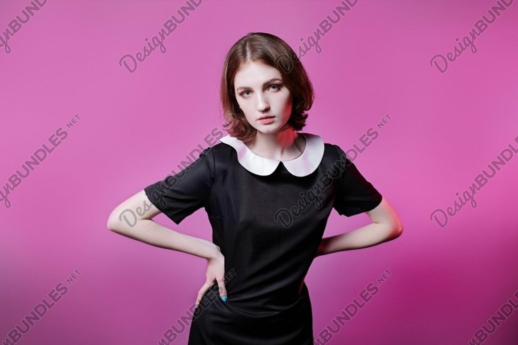 glamorous portrait of young girl in black dress
