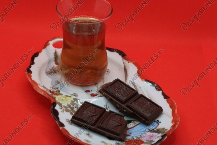 tea and chocolate on a saucer example image 1
