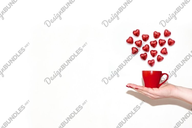 Valentines Day template with woman hand cup and sweet hearts