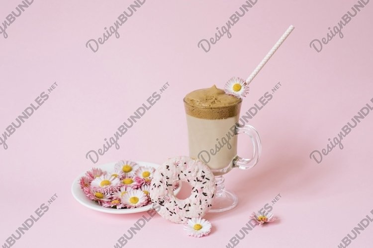 Trendy dalgona coffee in a transparent cup with a paper tube example image 1