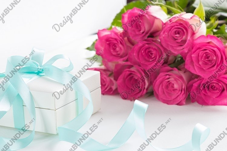 Gift box and bouquet of roses.