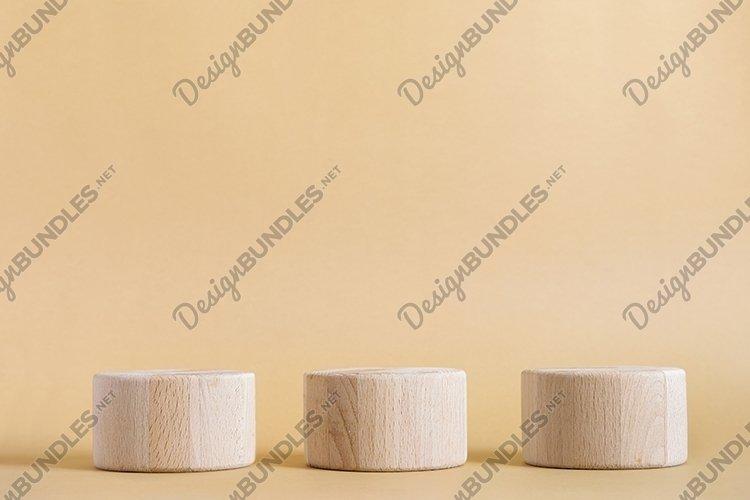 Tree wooden round cylinders podium on beige background example image 1