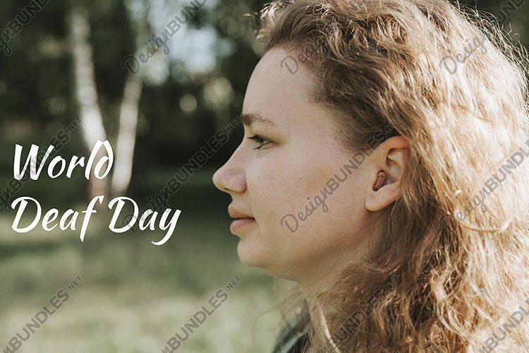 world deaf day text. small hearing aid in the ear of a woman example image 1