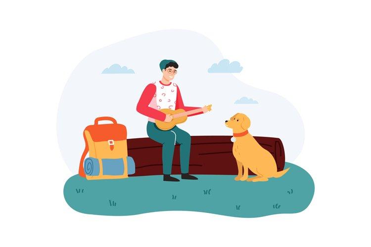 Boy sitting on log and playing guitar, dog sitting near hike example image 1