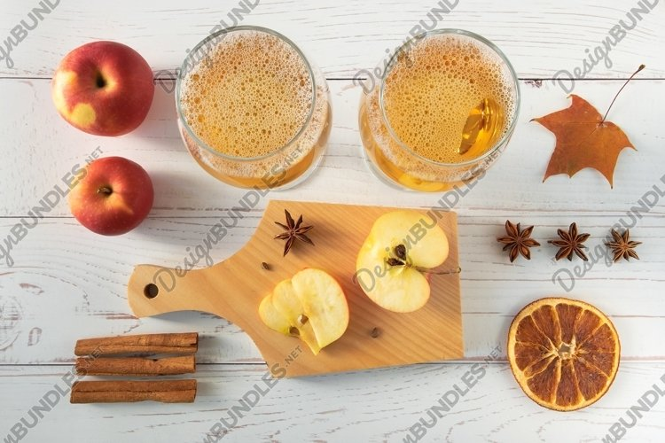 Ripe red apples, spices and glasses with cide example image 1