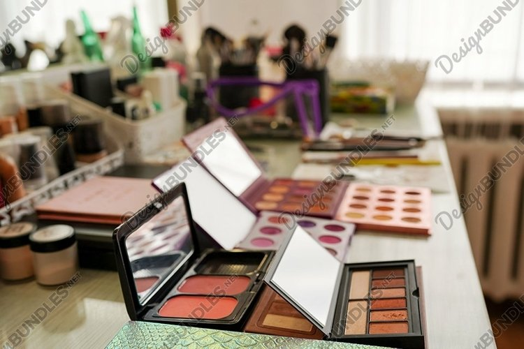 Makeup brushes and cosmetics on the table in beauty salon example image 1