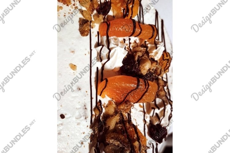 Sweet Birthday cake with cream, dried apricots, nuts photo example image 1