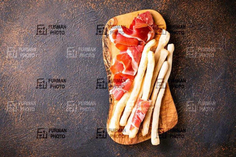 Italian antipasto grissini and proschiutto example image 1