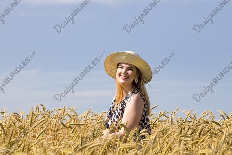 young girl in a wheat field example image 1