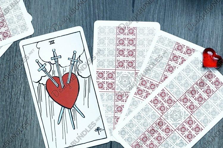 Tarot card reader arranges cards