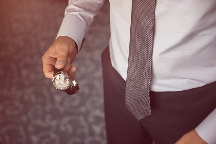 businessman looking at his watch on his hand