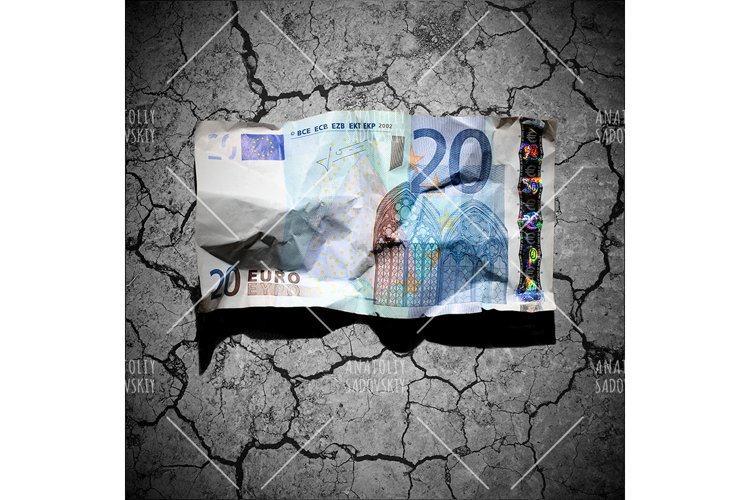 Crumpled 20 euro banknote on dry soil background
