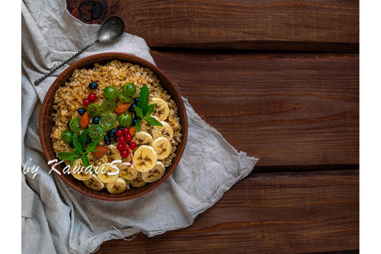 Wholegrain Oatmeal porridge bowl fresh berries copy space