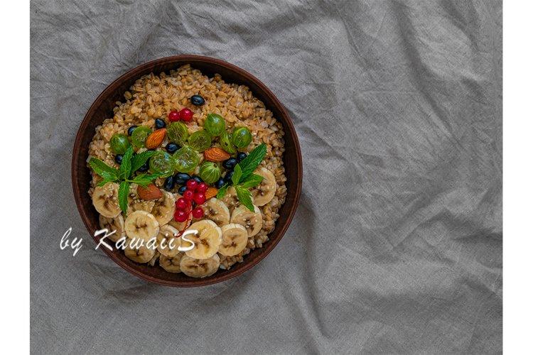 Wholegrain Oatmeal porridge bowl berries copy space on linen
